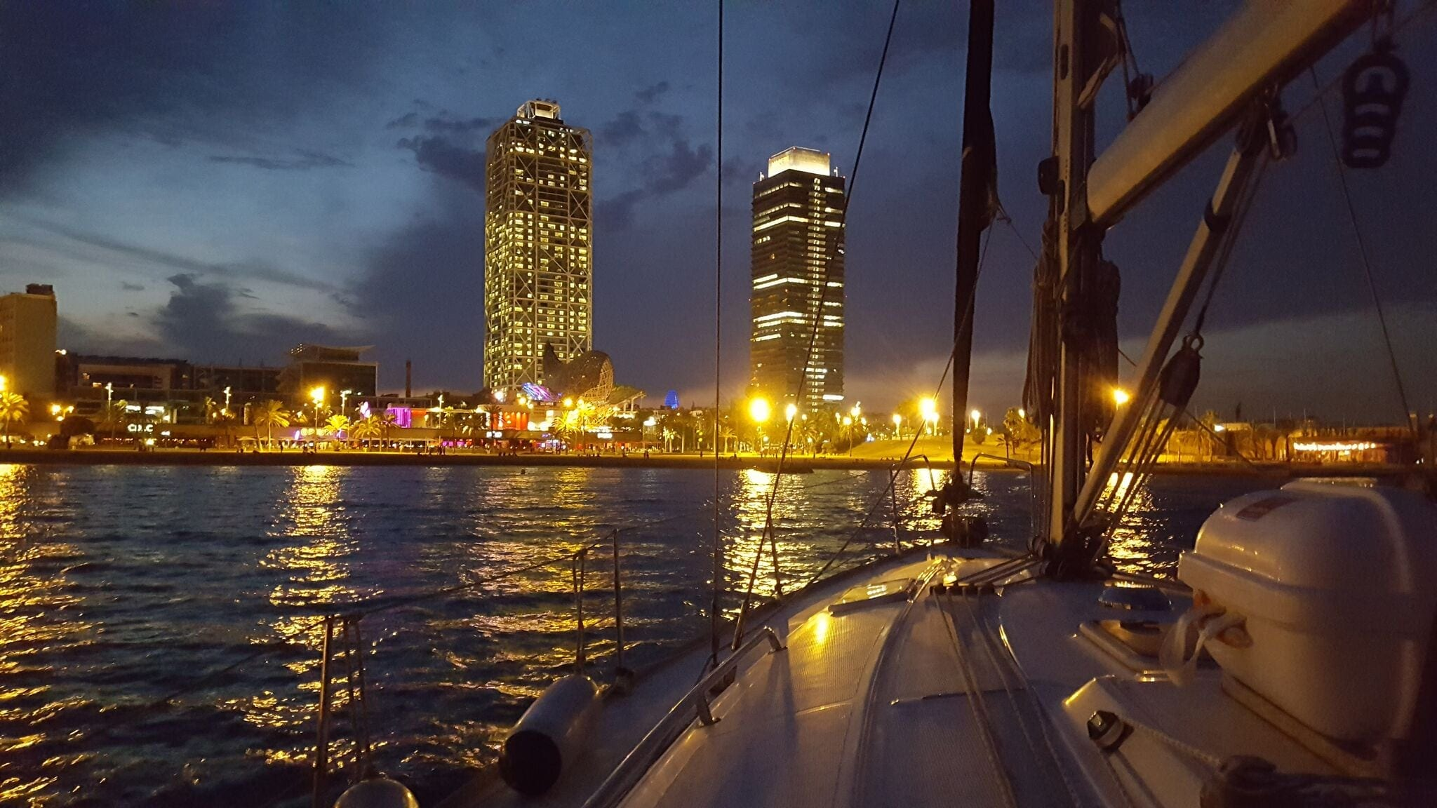 Skyline of Barcelona at night from the sea